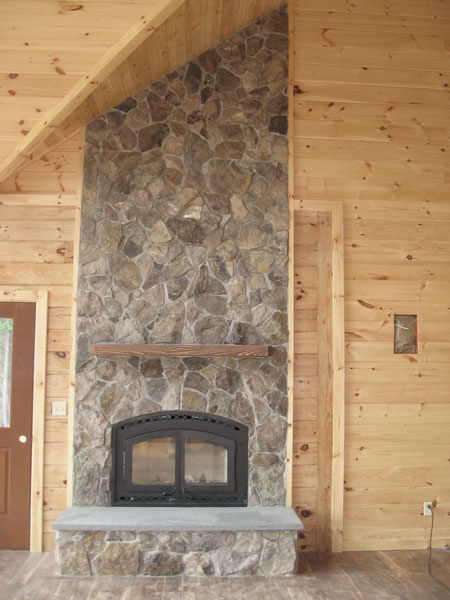 This Natural Field Rock Fireplace Adds To The Warm Tones Of The Natural  Wood In This Log Cabin (above).