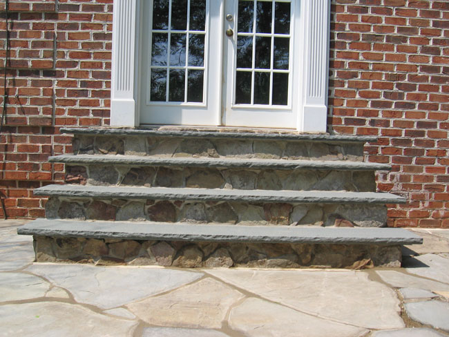 Stone Steps Leading From Patio To French Doors.